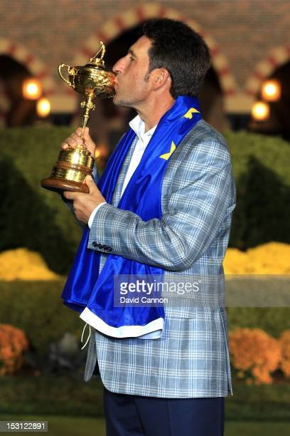 European team captain Jose Maria Olazabal kisses the Ryder Cup after Europe defeated the USA 145 to 135 to retain the Ryder Cup during the Singles...