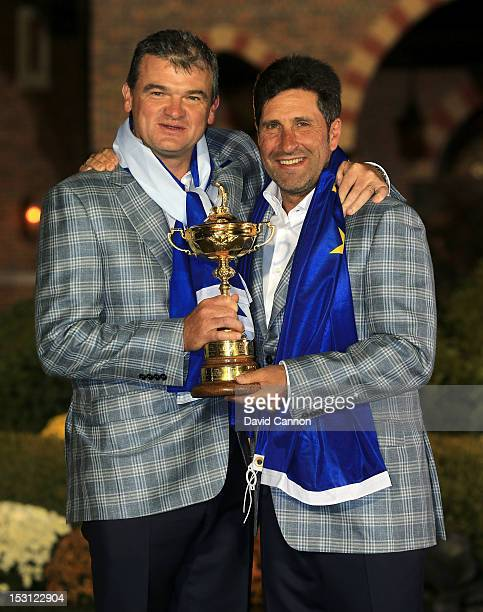 European team captain Jose Maria Olazabal poses with Paul Lawrie and the Ryder Cup after Europe defeated the USA 145 to 135 to retain the Ryder Cup...