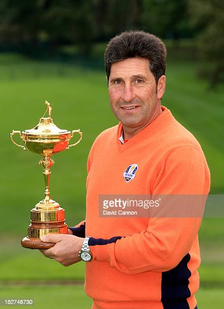 European Team captain Jose Maria Olazabal poses with the trophy during the second preview day of The 39th Ryder Cup at Medinah Country Golf Club on...