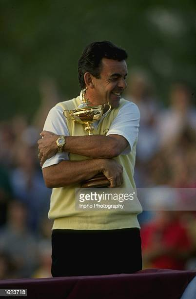 European team Captain Tony Jacklin of England hugs the trophy after winning the Ryder Cup at The Belfry Golf Club in Sutton Coldfield England The...