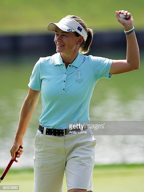 European Team member Catriona Matthew of Scotland waves to the crowd after finishing her foursomes match during the first round of the 2005 Solheim...