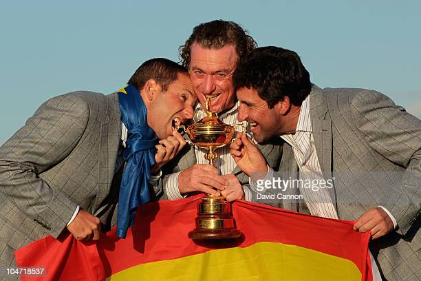 European Team members Sergio Garcia Miguel Angel Jimenez and Jose Maria Olazabal pose with the Ryder Cup following Europe's 145 to 135 victory over...