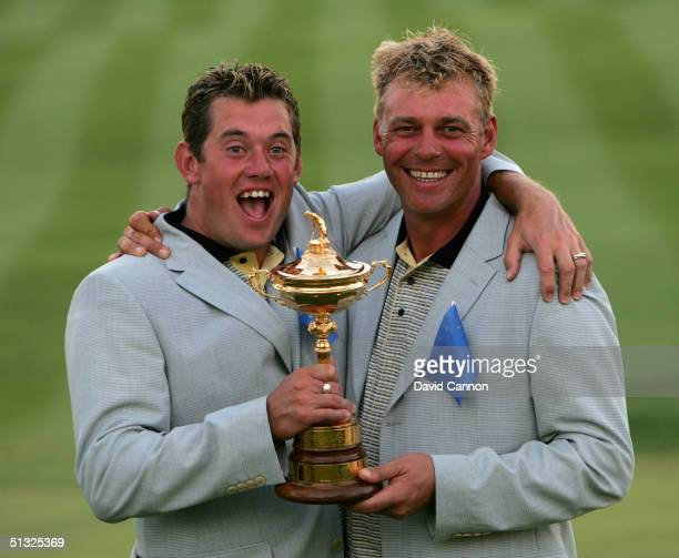 European team players Darren Clarke and Lee Westwood with the trophy after Europe's victory over the USA 18 1/2 to 9 1/2 at the 35th Ryder Cup...