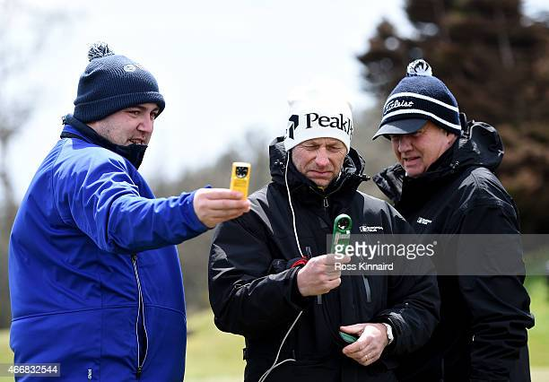 European Tour meteorologist Guy Nestor and European Tours refferees Mikael Eriksson and Thomas Waldenstedt check the wind speed during the delayed...