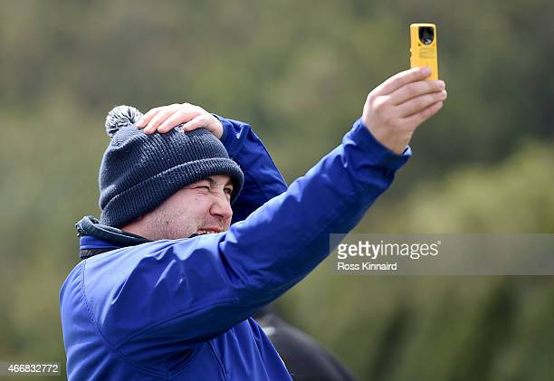 European Tour meteorologist Guy Nestor checks the wind speed during the delayed the first round of the Madeira Islands Open at the Santo da Serra...
