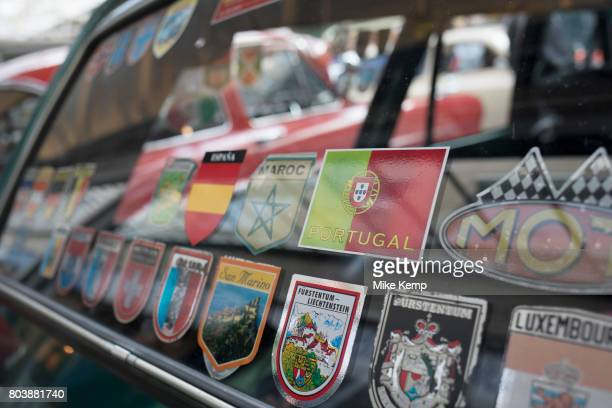 European travel flag stickers on the rear windscreen of a vintage car on show at a monthly meet up in Greenwich Market in London England United...