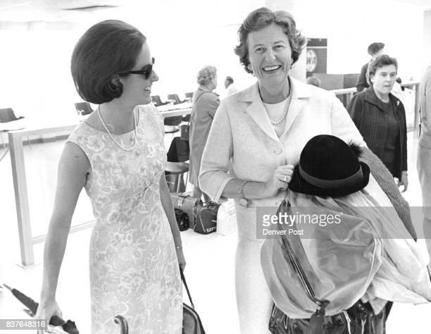 European Travelers Return On EnglishSpeaking Union Trip Miss Virginia Robinson left and her mother Mrs F George Robinson leave Stapleton terminal Mr...