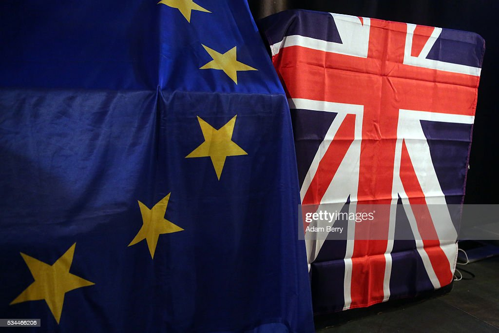 European Union (L) and British Union Jack flags hang at a meeting for British citizens living in Germany to discuss the implications of Great Britain leaving the European Union, known popularly as Brexit, on May 26, 2016 in Berlin, Germany. On June 23, 2016, UK citizens will vote on a post-legislative referendum on the country's membership in the European Union. Many British proponents of leaving the EU argue that it would allow the UK to better control immigration as well as save billions in membership fees as well as control trade deals and legislation, while those who wish to remain believe that leaving would decrease both the country's influence in world affairs as well as its security, and cause trade barriers with the rest of Europe.