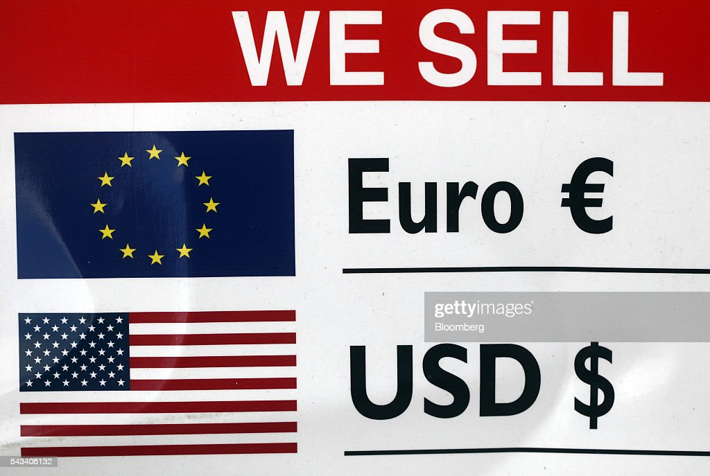 European Union (EU) and U.S. and flags sit on a board advertising euros and U.S. dollars outside a foreign currency exchange bureau in London, U.K., on Tuesday, June 28, 2016. The pound rose for the first time since the U.K.s vote to leave the European Union, as a recovery in investor appetite for higher-yielding assets seeped through currency markets. Photographer: Chris Ratcliffe/Bloomberg via Getty Images