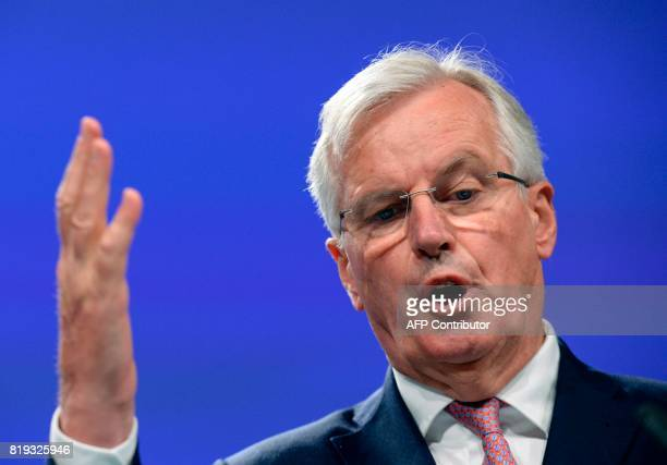European Union Chief Negotiator in charge of Brexit negotiations with Britain Michel Barnier gestures as he addresses media representatives during a...