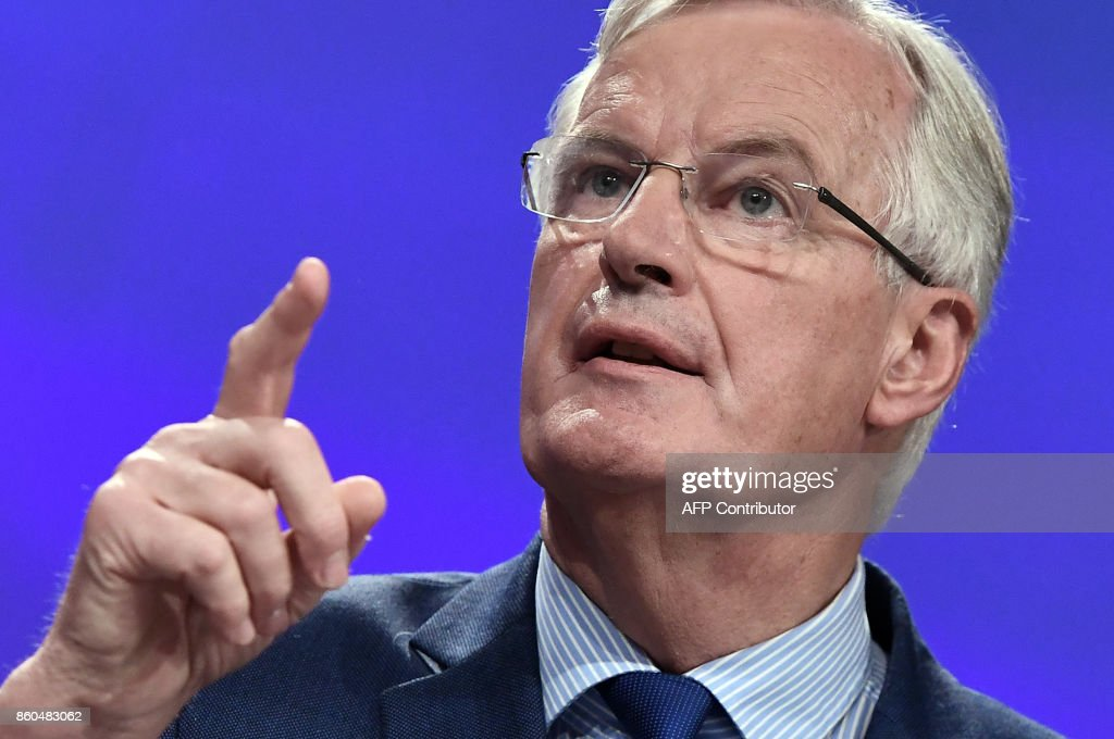 European Union Chief Negotiator in charge of Brexit negotiations with Britain Michel Barnier gestures as he addresses media representatives at the European Union Commission in Brussels on October 12, 2017. Brexit negotiations are deadlocked on the crucial issue of Britain's exit bill but a breakthrough remains possible in the next two months, the EU's chief negotiator Michel Barnier said on October 12. /