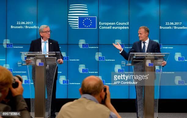 European Union Commission President JeanClaude Juncker and European Union Council President Donald Tusk speak to the media during a EU leaders summit...