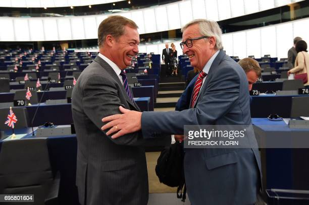 European Union commission President JeanClaude Juncker shakes hands with former leader of the UK Independence Party Nigel Farage prior to a meeting...