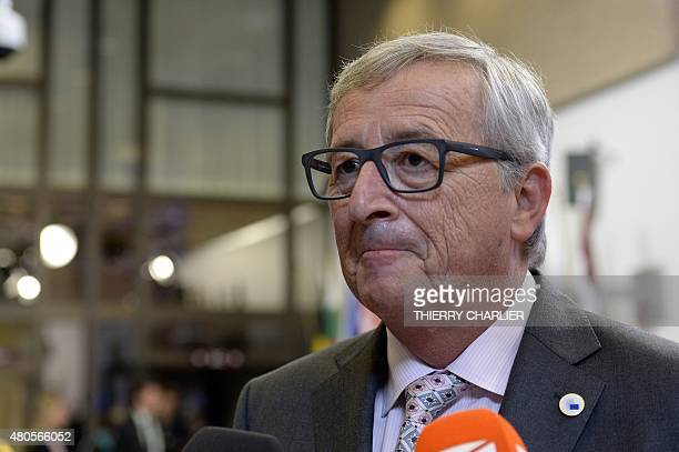 European Union Commission President JeanClaude Juncker talk to the media at the end of an Eurozone Summit over the Greek debt crisis in Brussels on...