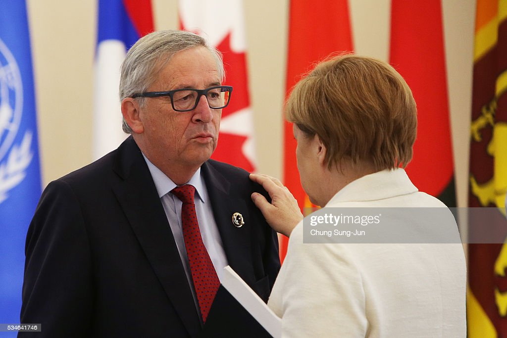 European Union Commission President <a gi-track='captionPersonalityLinkClicked' href=/galleries/search?phrase=Jean-Claude+Juncker&family=editorial&specificpeople=207032 ng-click='$event.stopPropagation()'>Jean-Claude Juncker</a> talks with German Chancellor <a gi-track='captionPersonalityLinkClicked' href=/galleries/search?phrase=Angela+Merkel&family=editorial&specificpeople=202161 ng-click='$event.stopPropagation()'>Angela Merkel</a> durng a 'Outreach Session' on May on May 27, 2016 in Kashikojima, Japan. In the two-day summit, the G7 leaders discussed the pressing global issues including counter-terrorism, energy policy, and sustainable development.