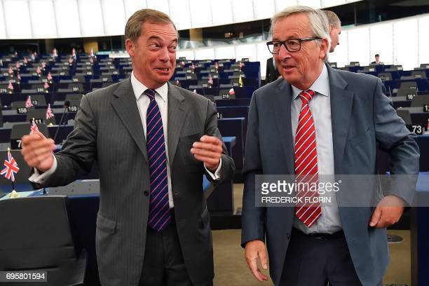 European Union commission President JeanClaude Juncker talks with former leader of the UK Independence Party Nigel Farage prior to a meeting at the...