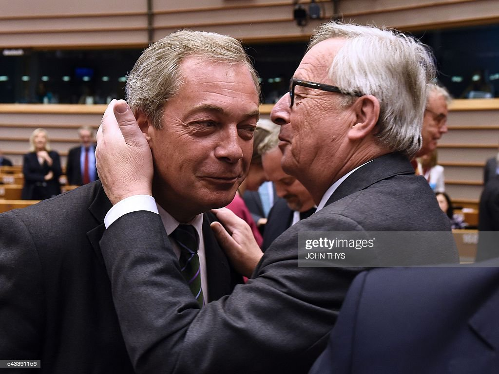 European Union (EU) Commission President Jean-Claude Juncker (R) welcomes United Kingdom Independence Party (UKIP) leader Nigel Farage (L) as he arrives ahead of a plenary session at the EU headquarters in Brussels on June 28, 2016. European Commission chief Jean-Claude Juncker called on June 28 on Prime Minister David Cameron to clarify quickly when Britain intends to leave the EU, saying there can be no negotiation on future ties before London formally applies to exit. European leaders gather in Brussels for a crunch two-day summit set to be dominated by Britain's departure from the bloc following its shock referendum last week. / AFP / JOHN