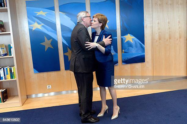 European Union Commission President JeanClaude Juncker welcomes Scotland's First Minister and Leader of the Scottish National Party Nicola Sturgeon...