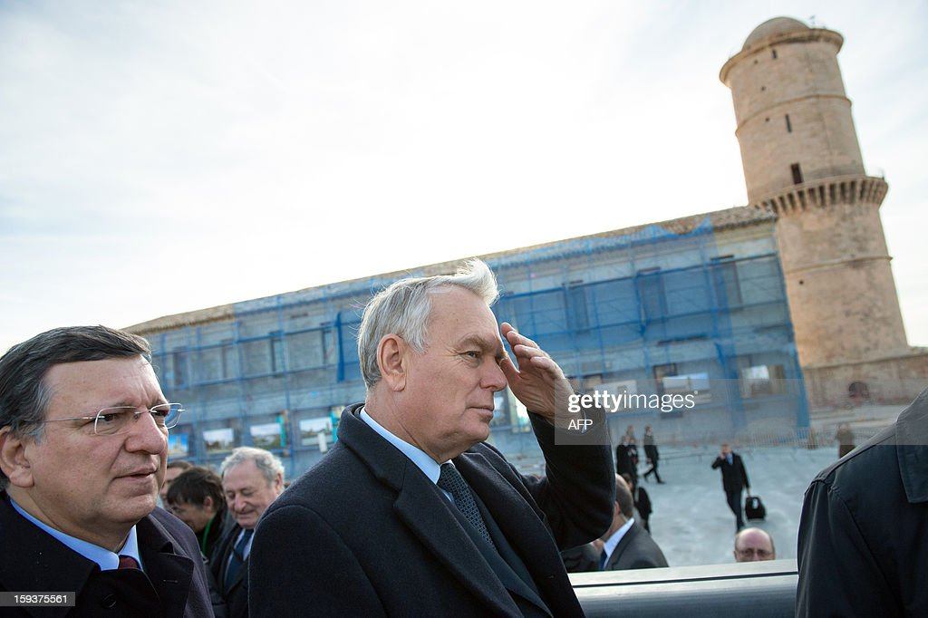 European Union (EU) Commission President Jose Manuel Barroso, and France's Prime Minister Jean-Marc Ayrault visit Saint-Jean fort work site as part of the opening festivities marking Marseille as the 2013 European Capital of Culture on January 12, 2013 in Marseille, southeastern France. AFP PHOTO / POOL / BERTRAND LANGLOIS