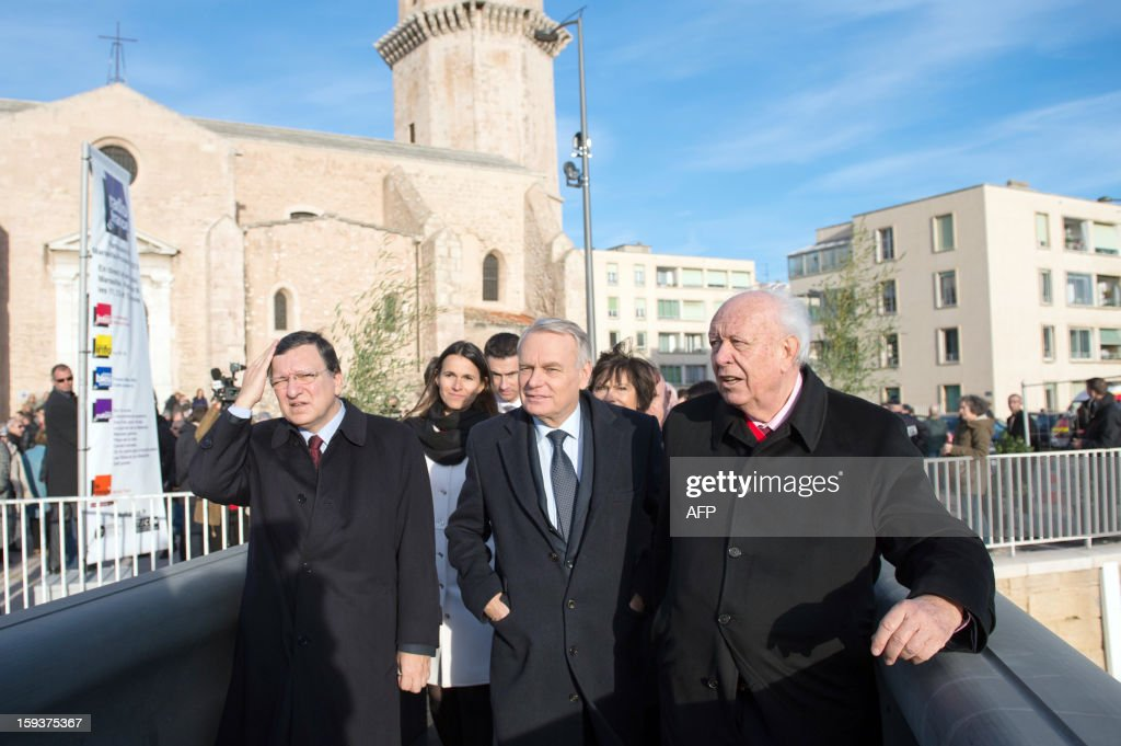 European Union (EU) Commission President Jose Manuel Barroso, France's Culture minister Aurelie Filippetti, France's Prime Minister Jean-Marc Ayrault and Marseille's Mayor Jean-Claude Gaudin arrive to visit Saint-Jean fort work site as part of the opening festivities marking Marseille as the 2013 European Capital of Culture on January 12, 2013 in Marseille, southeastern France. AFP PHOTO / POOL / BERTRAND LANGLOIS