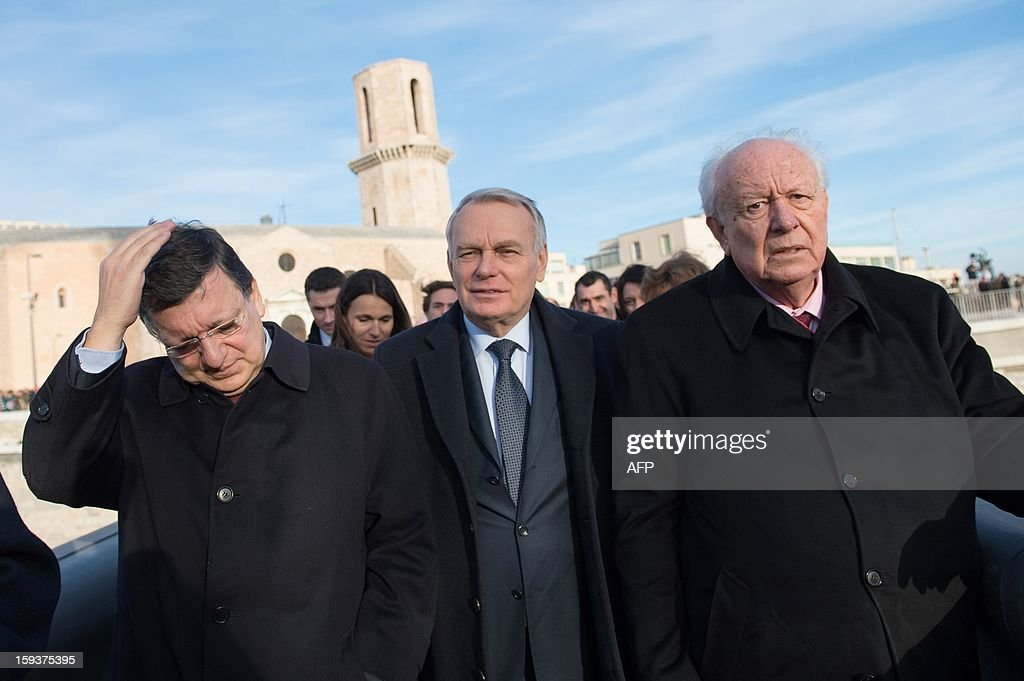 European Union (EU) Commission President Jose Manuel Barroso, France's Prime Minister Jean-Marc Ayrault and Marseille's Mayor Jean-Claude Gaudin arrive to visit Saint-Jean fort work site as part of the opening festivities marking Marseille as the 2013 European Capital of Culture on January 12, 2013 in Marseille, southeastern France. AFP PHOTO / POOL / BERTRAND LANGLOIS
