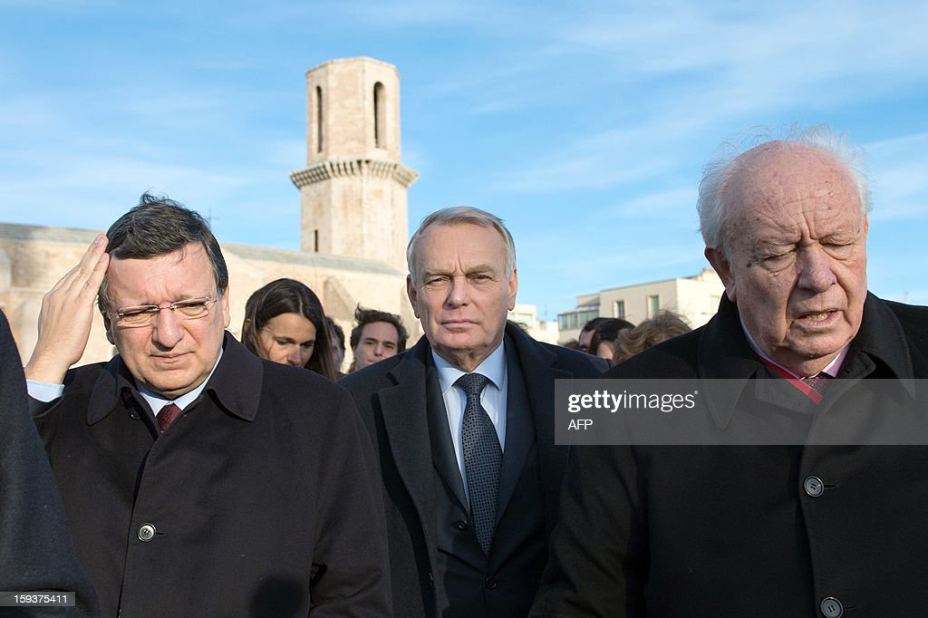 European Union (EU) Commission President Jose Manuel Barroso, France's Prime Minister Jean-Marc Ayrault and Marseille's Mayor Jean-Claude Gaudin arrive to visit Saint-Jean fort work site as part of the opening festivities marking Marseille as the 2013 European Capital of Culture on January 12, 2013 in Marseille, southeastern France.