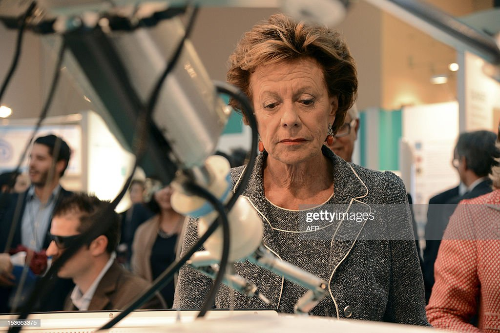 European Union Commissioner for Digital Agenda Neelie Kroes looks at a robot during the exhibition 'Made in Europe' held at the European Parliament in Brussels on October 8, 2012. AFP PHOTO / Thierry Charlier