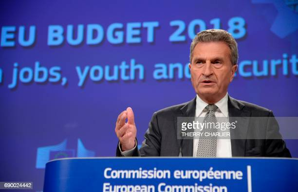 European Union Commissioner for Digital Economy and Society Gunther Oettinger speaks during a press conference announcing the EU Commission's...
