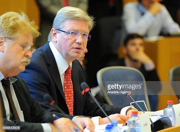 European Union Commissioner for Enlargement and Neighbourhood Stefan Fule is seen with the Chairman of the European Parliament Committee on Foreign...