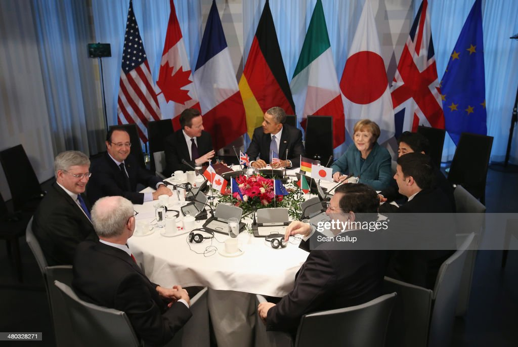 European Union Council President <a gi-track='captionPersonalityLinkClicked' href=/galleries/search?phrase=Herman+Van+Rompuy&family=editorial&specificpeople=4476281 ng-click='$event.stopPropagation()'>Herman Van Rompuy</a>, Canadian Prime Minister <a gi-track='captionPersonalityLinkClicked' href=/galleries/search?phrase=Stephen+Harper&family=editorial&specificpeople=690870 ng-click='$event.stopPropagation()'>Stephen Harper</a>, French President Francois Hollande, British Prime Minister <a gi-track='captionPersonalityLinkClicked' href=/galleries/search?phrase=David+Cameron+-+Politiker&family=editorial&specificpeople=227076 ng-click='$event.stopPropagation()'>David Cameron</a>, U.S. President <a gi-track='captionPersonalityLinkClicked' href=/galleries/search?phrase=Barack+Obama&family=editorial&specificpeople=203260 ng-click='$event.stopPropagation()'>Barack Obama</a>, German Chancellor <a gi-track='captionPersonalityLinkClicked' href=/galleries/search?phrase=Angela+Merkel&family=editorial&specificpeople=202161 ng-click='$event.stopPropagation()'>Angela Merkel</a>, Japanese Prime Minister <a gi-track='captionPersonalityLinkClicked' href=/galleries/search?phrase=Shinzo+Abe&family=editorial&specificpeople=559017 ng-click='$event.stopPropagation()'>Shinzo Abe</a>, Italian Prime Minister <a gi-track='captionPersonalityLinkClicked' href=/galleries/search?phrase=Matteo+Renzi&family=editorial&specificpeople=6689301 ng-click='$event.stopPropagation()'>Matteo Renzi</a> and European Union Commission President Jose Manuel Barroso chat during a meeting of G7 leaders on March 24, 2014 in The Hague, Netherlands. The G7 leaders are meeting to dicuss the current crisis in Ukraine during the 2014 Nuclear Secuirty Summit in The Hague.