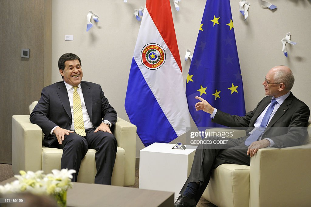 European Union (EU) Council president Herman Van Rompuy (R) meets with Paraguay's president-elect Horacio Cartes (L) prior to their working session on June 25, 2013 at the EU Headquarters in Brussels.