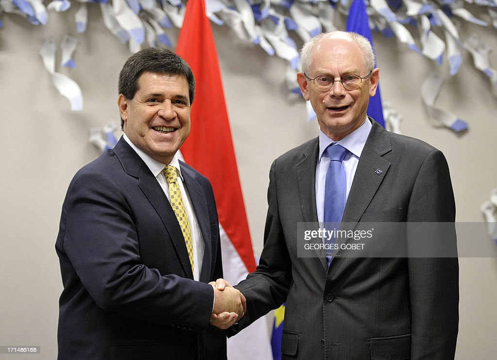 European Union (EU) Council president Herman Van Rompuy (R) welcomes Paraguay's president-elect Horacio Cartes (L) prior to their working session on June 25, 2013 at the EU Headquarters in Brussels.