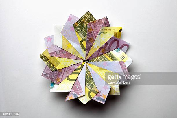 European Union currency folded into a pinwheel shape