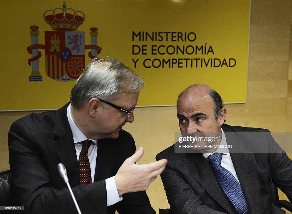 European Union Economic and Monetary Affairs commissioner Olli Rehn (L) speaks with Spanish Minister for Economy and Competitiveness Luis de Guindos during a press conference in Madrid on January 28, 2013.