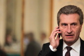 European Union Energy Commissioner Guenther Oettinger talks on his cell phone during day1 of the 48th Munich Security Conference at Hotel Bayerischer...
