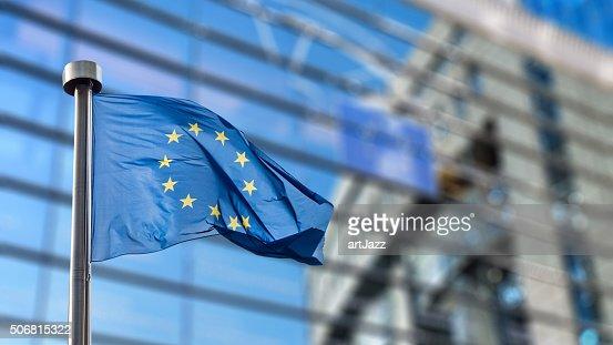 European Union flag against European Parliament : Stock Photo