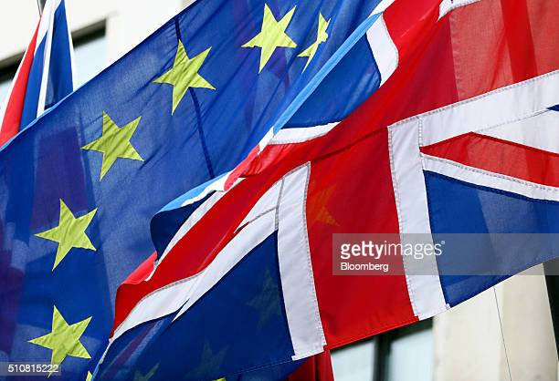 A European Union flag center flies in between two British Union flags commonly known as a Union Jacks in London UK on Wednesday Feb 17 2016 German...