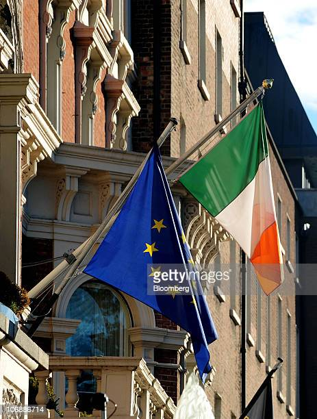 A European Union flag flies alongside the Irish national flag in Dublin Ireland on Monday Nov15 2010 European Central Bank Vice President Vitor...