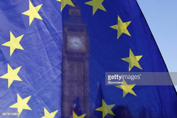 A European Union flag flies in front of Elizabeth Tower commonly referred to as Big Ben during a Unite for Europe march to protest Brexit in central...