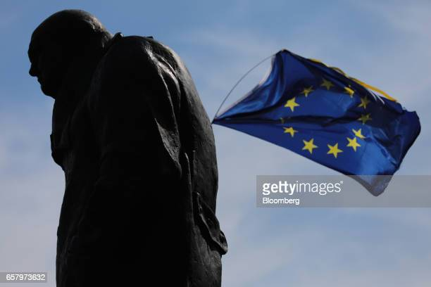 A European Union flag flies near to a statue of Winston Churchill former British prime minister during a Unite for Europe march to protest Brexit in...