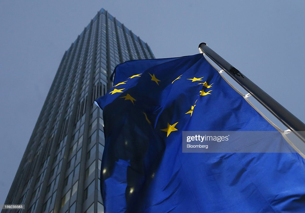 A European Union flag flies outside the European Central Bank (ECB) headquarters in Frankfurt, Germany, on Wednesday, Jan. 9, 2013. German two-year notes declined, pushing yields to the highest in 11 weeks, after European Central Bank President Mario Draghi said the decision to leave the key interest rate at 0.75 percent was 'unanimous.' Photographer: Ralph Orlowski/Bloomberg via Getty Images