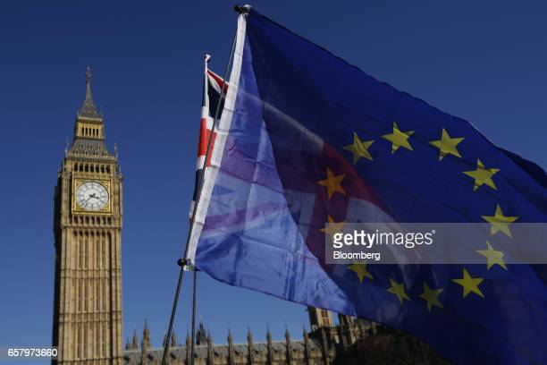 A European Union flag front and a Union flag also known as Union Jack fly in front of Elizabeth Tower commonly referred to as Big Ben during a Unite...