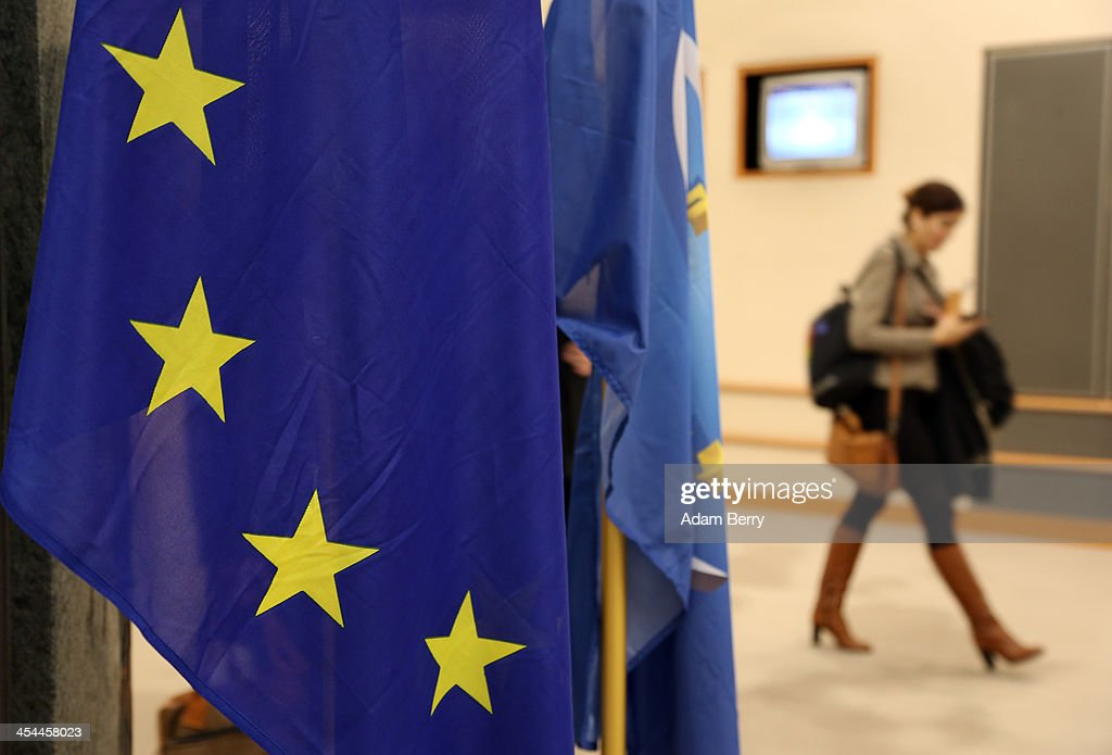 A European Union flag hangs in the European Parliament building on December 4, 2013 in Brussels, Belgium. The legislative body also has representation in Strasbourg and Brussels.