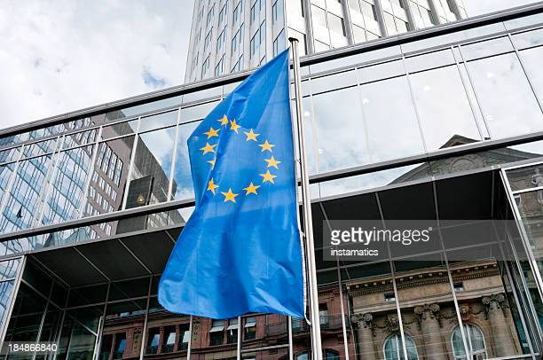 European Union flag in front of the Eurotower in Frankfurt