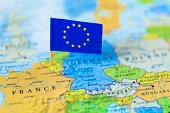 European Union flag over Europe map