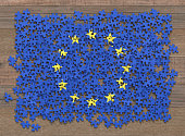 Flag of the European Union in disorganized pieces of a puzzle.