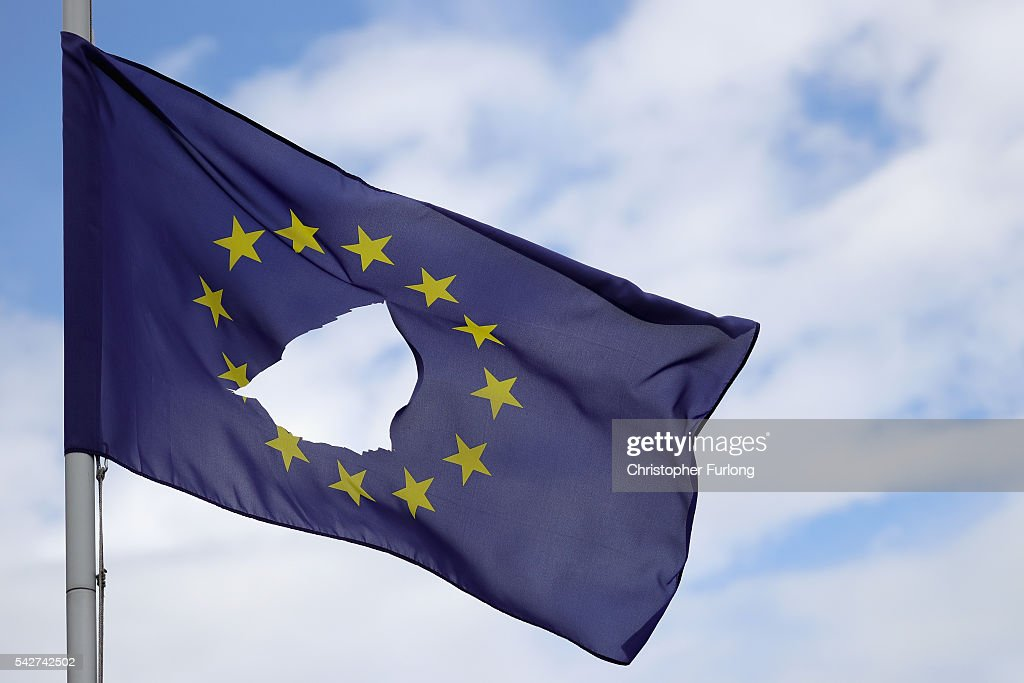http://media.gettyimages.com/photos/european-union-flag-with-a-hole-cut-in-the-middle-flies-at-halfmast-picture-id542742502