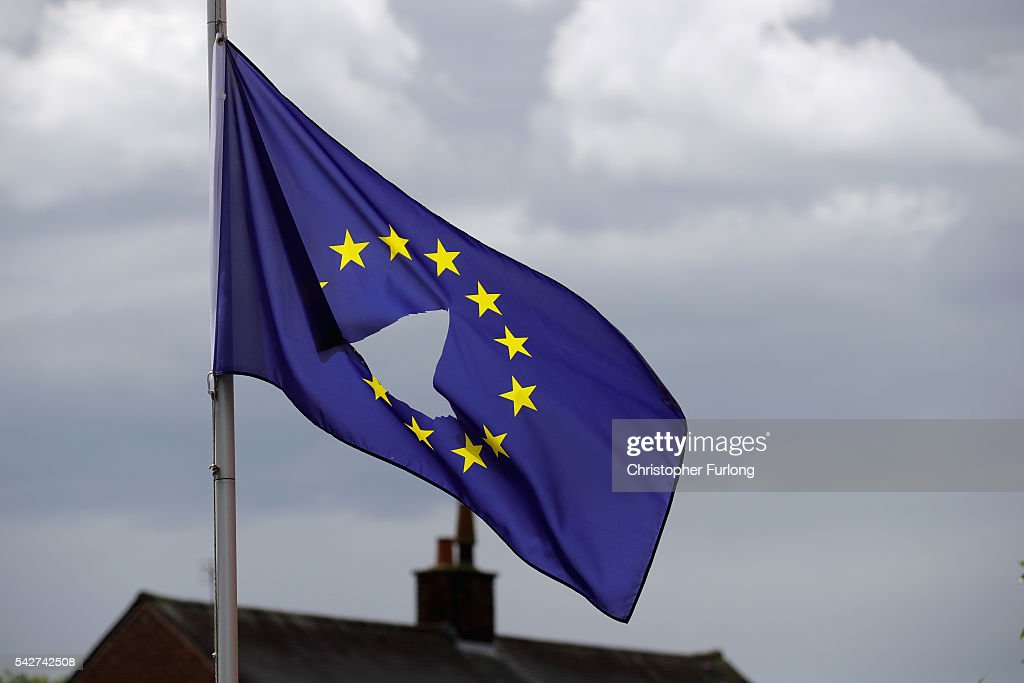 European Union flag with a hole cut in the middle flies at halfmast outside a home in Knutsford Cheshire after today's historic referendum on June 24...