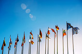 Flags in front of the European Parliament against beautiful blue sky in Strasbourg, Alsace, France