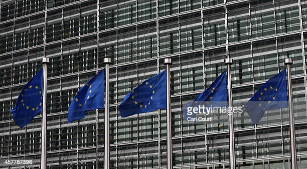 European Union flags are pictured outside the European Commission building on October 24 2014 in Brussels Belgium Alongside criticism from outgoing...